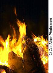 Radiate Campfire Against Black Night Sky