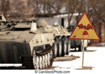 Radiation hazard sign with tanks
