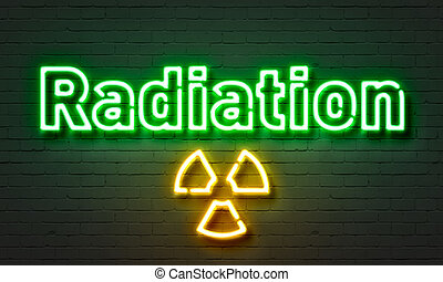 Radiation neon sign on brick wall background. - Radiation...