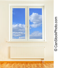 Radiator and window with blue sky view