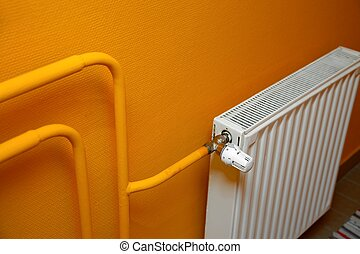 Radiator - Heating radiator detail against orange wall