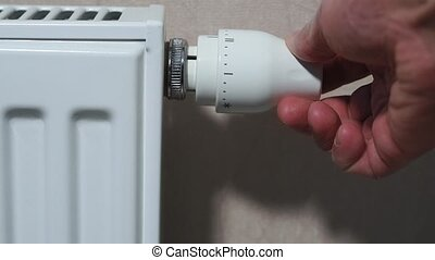 radiator., homme, température, main, ajustement, thermostat