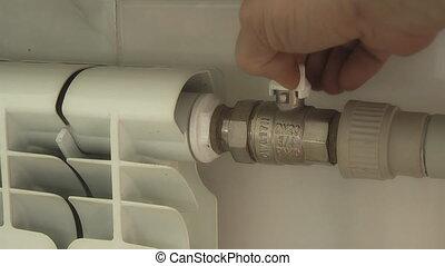 Radiator,  - human hand regulates heat