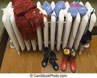 Radiator in Winter - Mittens, hat, scarf, and boots, drying...