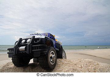 Radio control car - Radio control monster truck on a beach ...