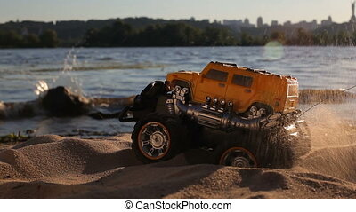 Radio-controlled car was stuck in the pit at the river side...