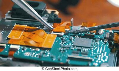 Radio Engineer Repairing Electronic Circuit Board. Radio...
