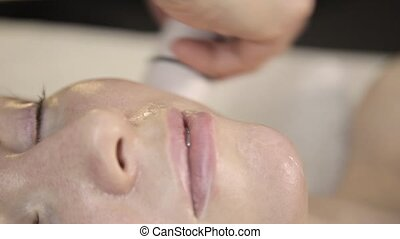 Radio frequency treatment. Beautician does rf-lifting...
