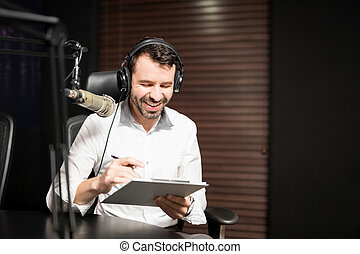 Radio jockey interviewing a guest from studio