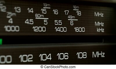 Radio panel is looking for desired radio wave. Closeup shot...