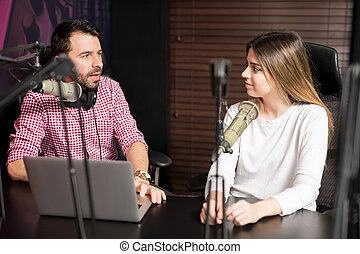 Radio presenter interviewing a guest for podcast