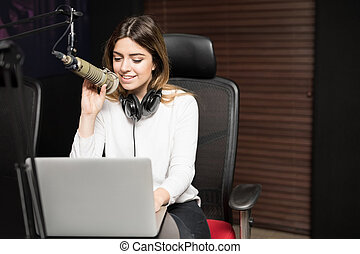 Radio presenter interviewing a guest from studio