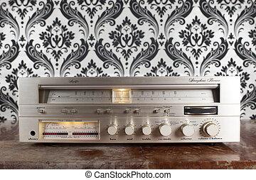 radio receiver against retro wallpaper