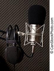 Radio studio, microphone and big headphone