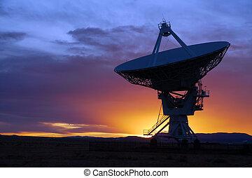 Radio telescope - Silhouette of a radio telescope at the...