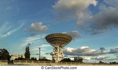 radio telescope taymlaps - racing clouds over a large radio...
