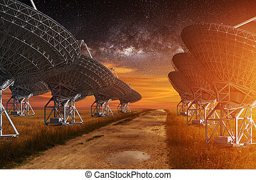 Radio Telescope view at night with milky way in the sky
