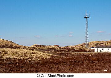 Radio tower between dunes