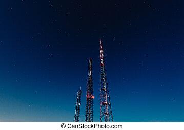 radio transmission antennas on the starry sky - media broadcasting concept