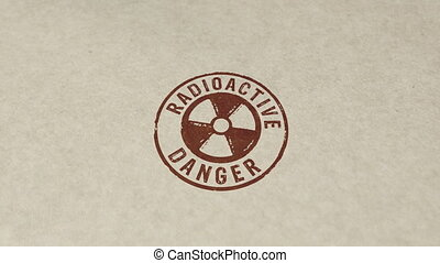 Radioactive danger symbol stamp and hand stamping impact animation. Atomic energy warning, radiation alert and nuclear power hazard 3D rendered concept.
