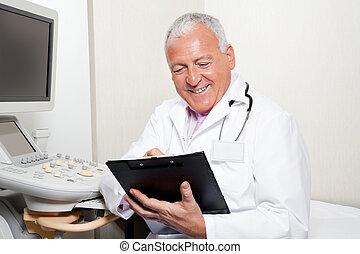 radiológus, csipeszes írótábla, birtok