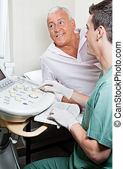 Radiologic Technologist With Patient