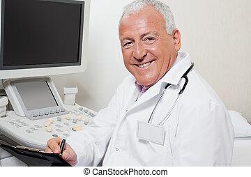 Radiologist Writing On Clipboard - Portrait of happy senior...
