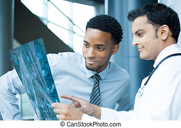 radiologists at work - Closeup portrait of intellectual...