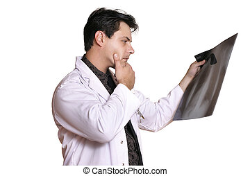 Radiology - A man reviews patient x-ray looking for signs of...