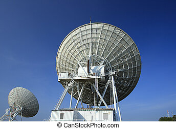 Radiotelescopes at the Very Large Array with blue sky background