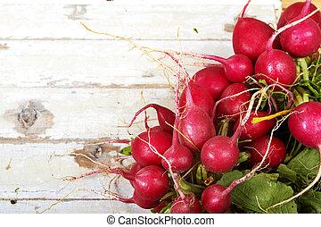 radish on grunge background - Close-up of a big bunch of...