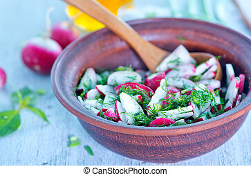 radish salad in bowl and on a table