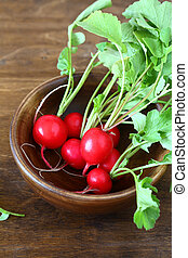radish with leaves in a bowl,