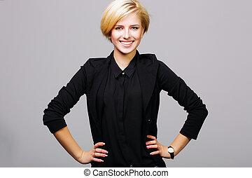 radosny, młoda kobieta, w, czarnoskóry dostosowują, na, szare tło