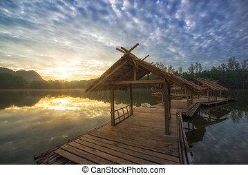 raft on lake at sunrise