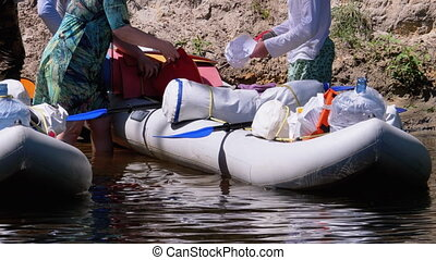 Rafting Boats with Tourist Stuff and Provisions Parked Along...