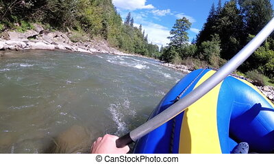 Rafting in the First Person on a Rough Mountain River. POV. ...