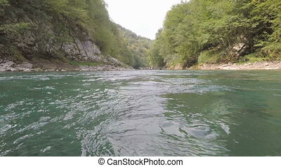 Rafting on the river Tara in the summer, Montenegro. boat...