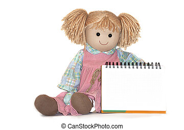 rag-dollnext to a blank paper sheet in cage, on white background