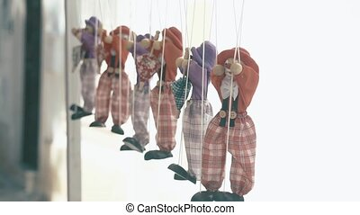 Rag dolls hang in a row on a rope - Rag dolls hang in a row...