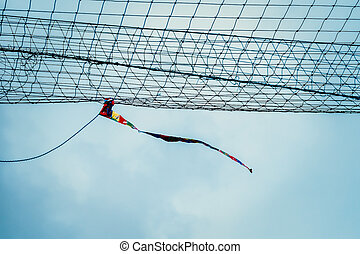 Rag tied to the net blowing in sport field