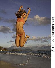 ragazza, a, spiaggia, saltare