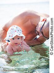 ragazza bambino, godere, mare, nuoto