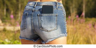 ragazza, primo piano, smartphone, jeans, tasca posteriore, nero