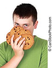 ragazzo adolescente, biscotti
