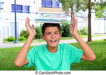 ragazzo, adolescente, studente, testa tiene, accatastato, libri