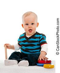 ragazzo bambino, moquette, giocattoli