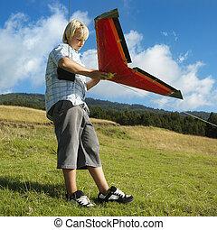 ragazzo, giocattolo, aeroplano.