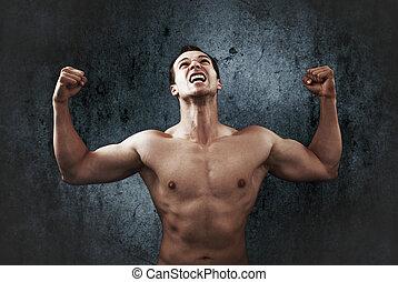 Rage scream of muscular strong man