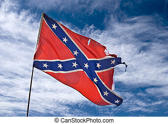 confederate flag - ragged confederate flag flying against...